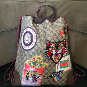 gucci courier supreme gg drawstring backpack